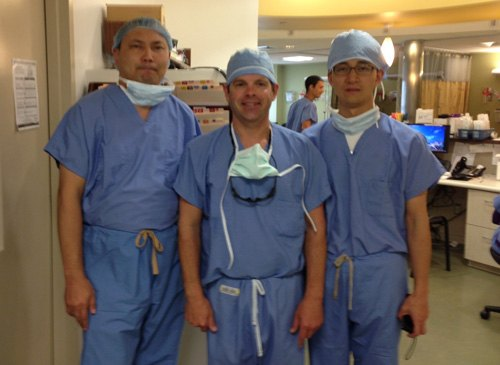Dr McLaughlin with visiting surgeons from China. A group of orthopedic surgeons from China visited Dr McLaughlin in the operating room to observe his surgical tehcniques. They were impressed with his skills and have invited him to travel to China to teach other orthopedic surgeons in the spring of 2014.